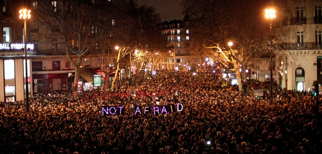 Parisian crowd holding banner