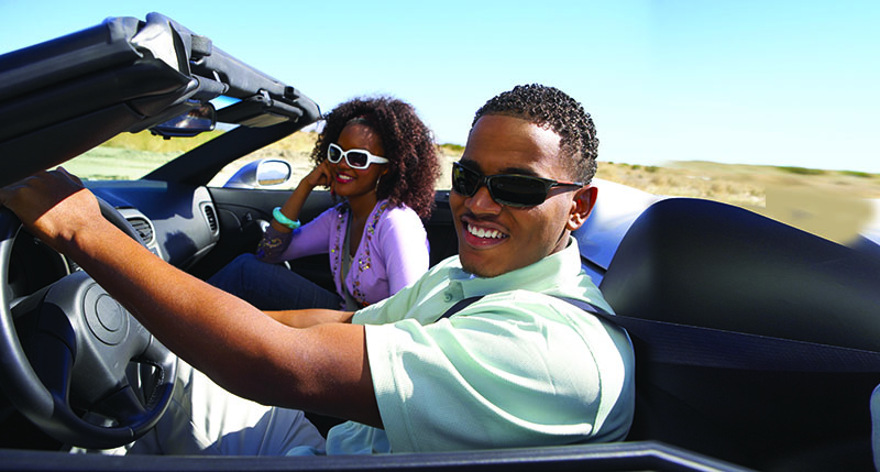 Man and woman in convertible
