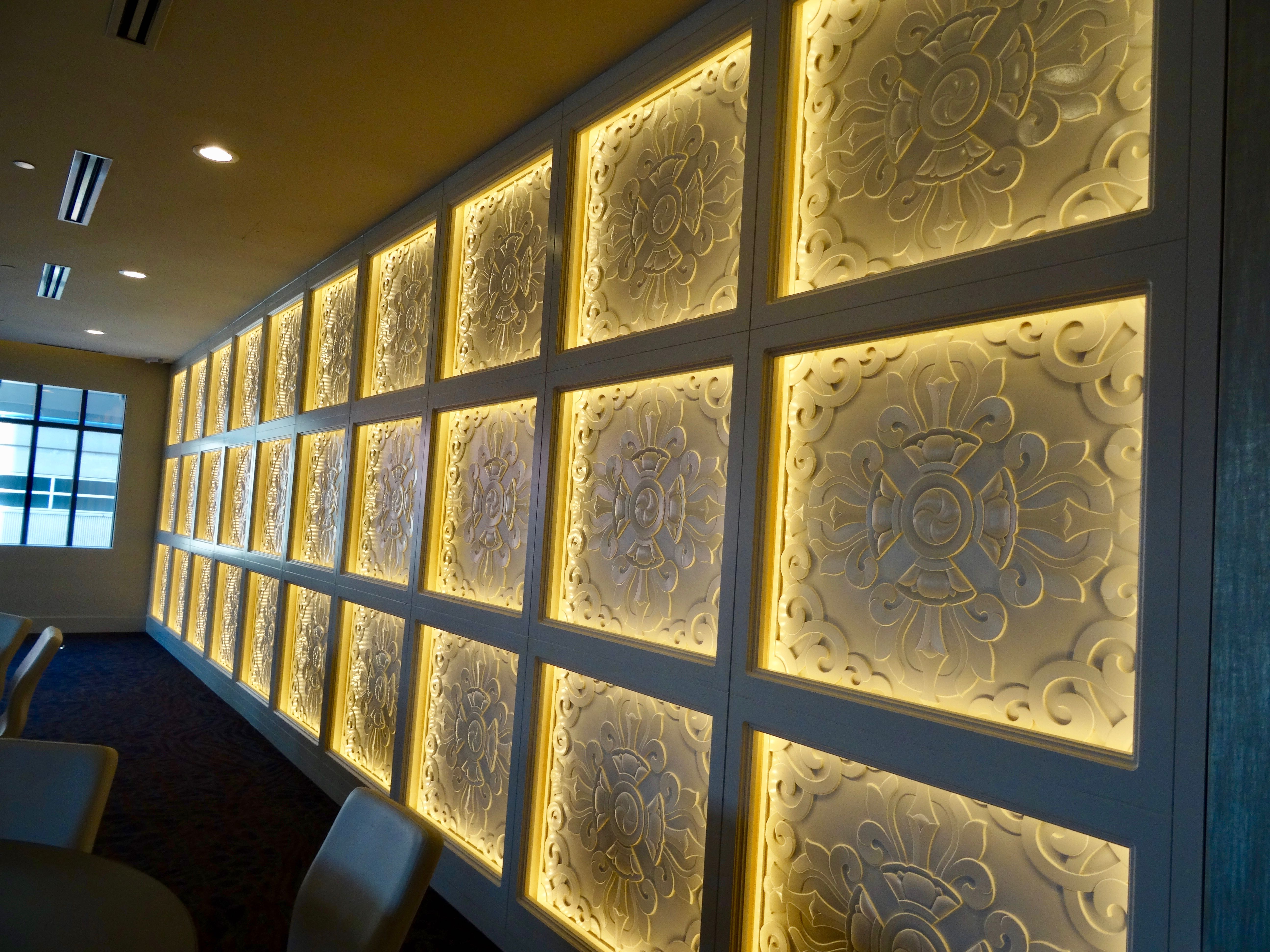 Hand-carved tile statement wall at Hotel Ivy Minneapolis