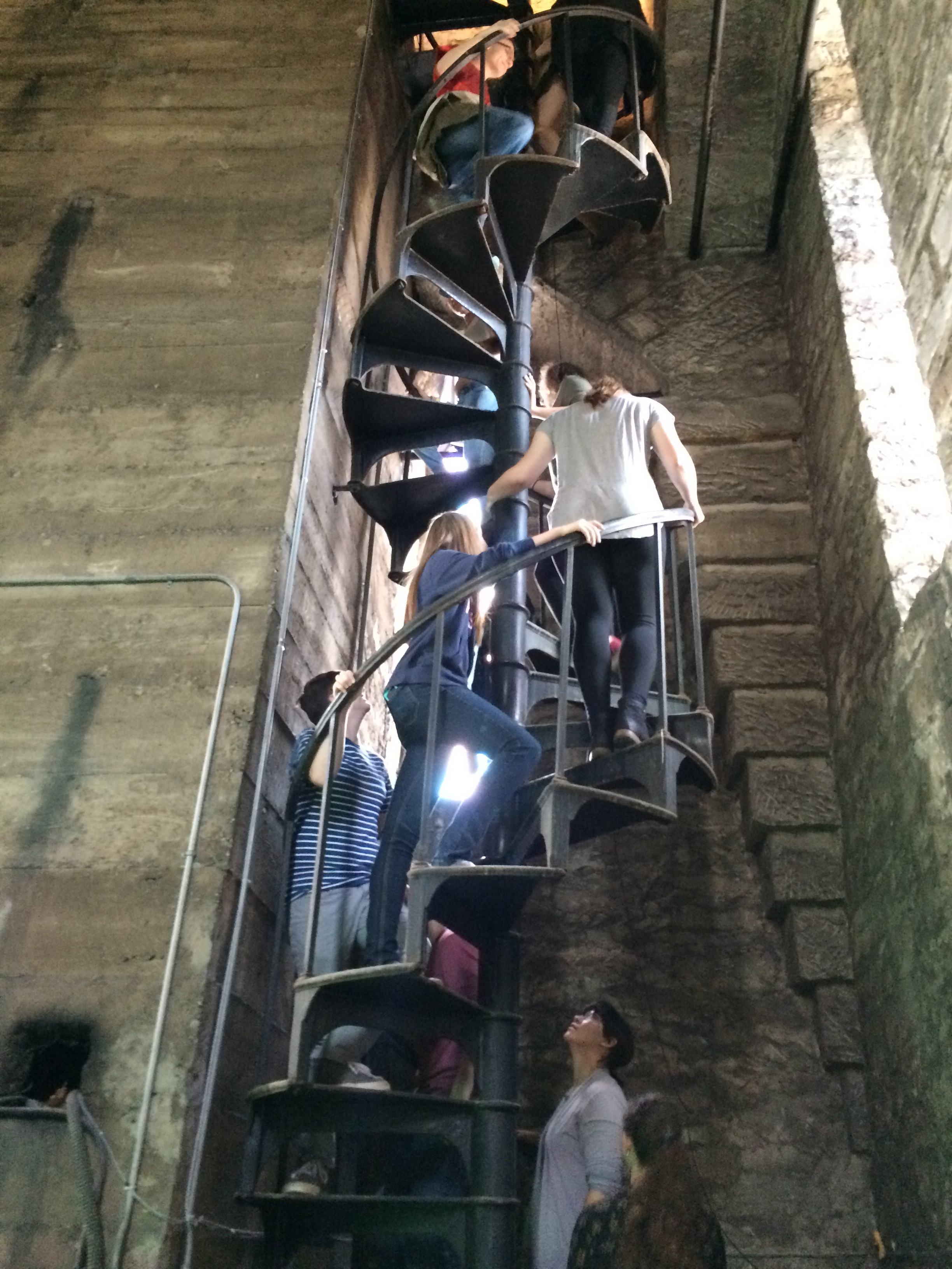 Visitors climb the spiral staircase to the tower.