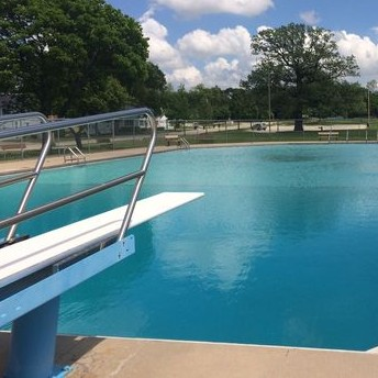 Pool and diving board in De Pere