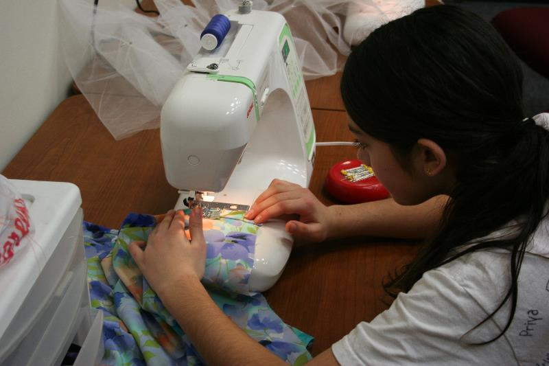Student sewing a new piece of clothing