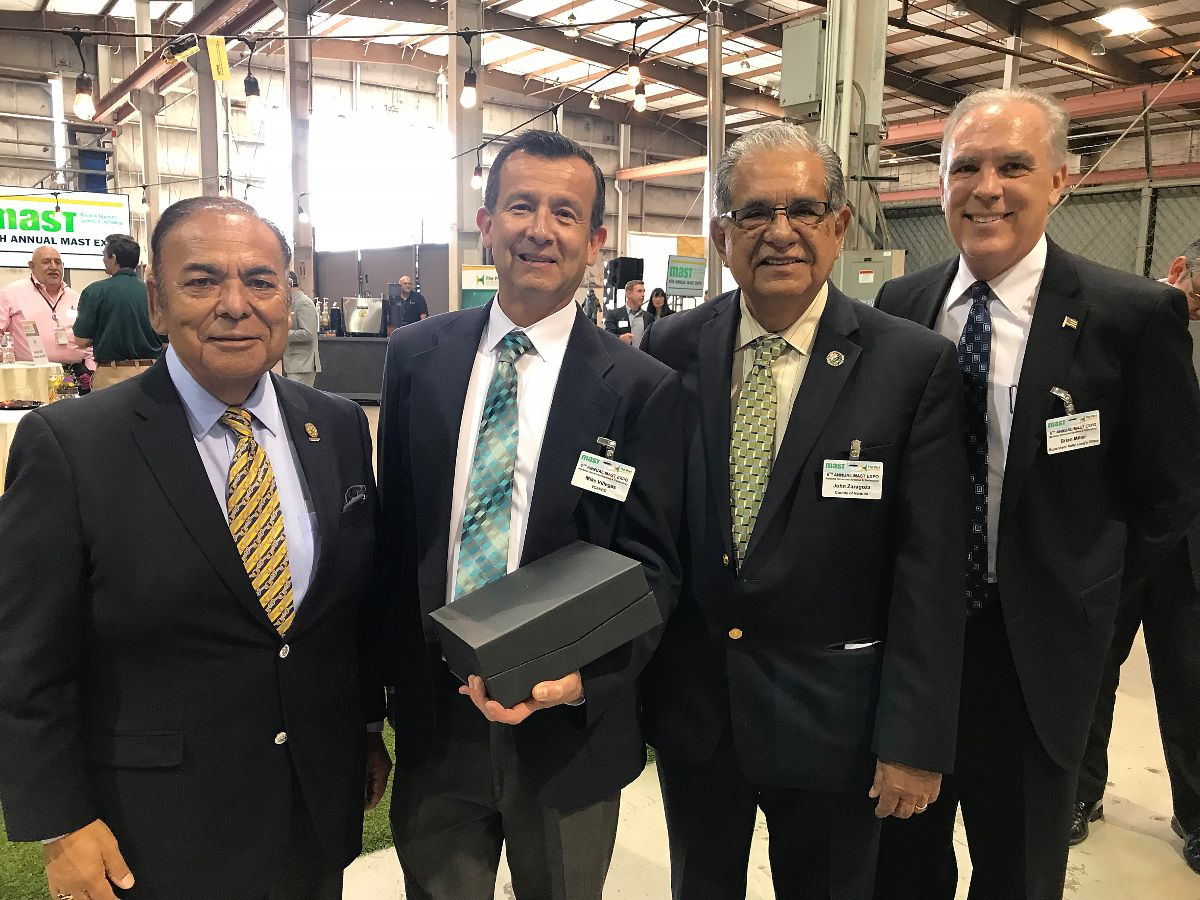Oxnard Harbor District President Jess Herrera joined by Supervisor John Zaragoza and Supervisor Kelly Long's Chief of Staff Brian Miller to congratulate VCAPCD's Mike Villegas (second from left) on his Lifetime Achievement Award