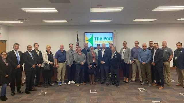 Port leadership, customers, and business community leaders pose at roundtable discussion