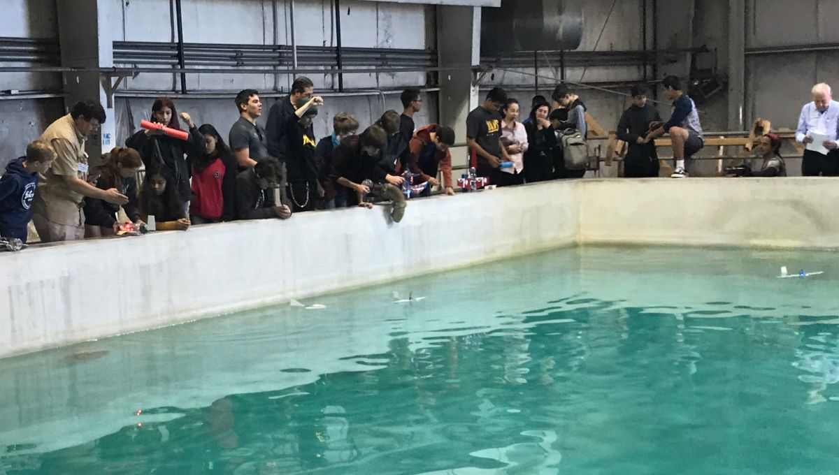 Local students showcase their SeaGlide underwater robots in the Port's dive tank