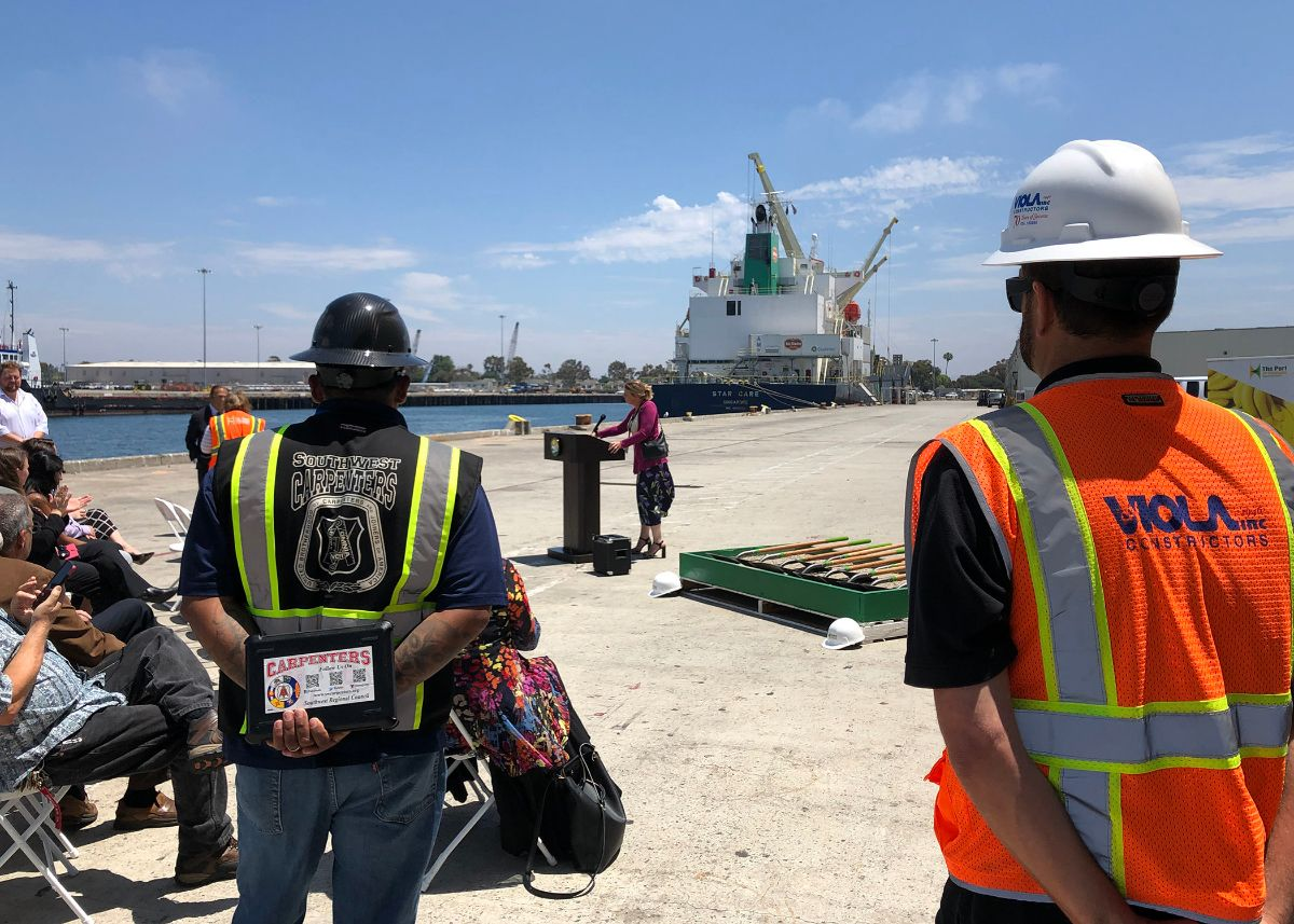 Armando Delgado of the Southwest Regional Council of Carpenters and Nick Shipp of Viola Constructors, Inc. listen to CEO & Port Director Kristin Decas explain the logistics of the project