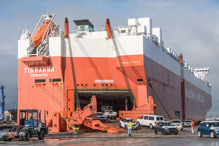 Local workers unload new automobiles from the WWO vessel at the Port of Hueneme