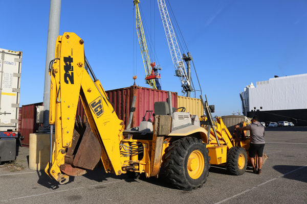 Backhoe being loaded and headed to Costa Rica on the Del Monte vessel.