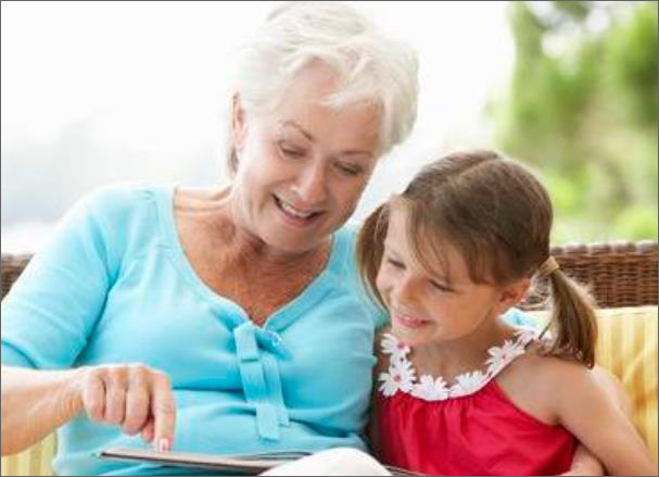 Grandmother reading to young grand daughter.