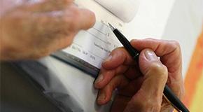 Senior Writing a Check