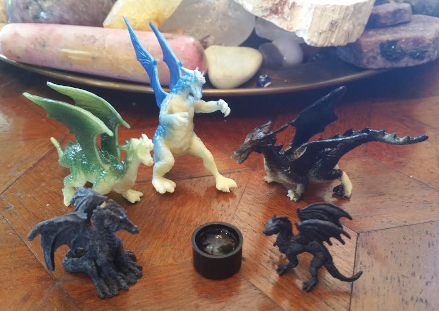 Examples of plastic dragons to use for this month's magic.
