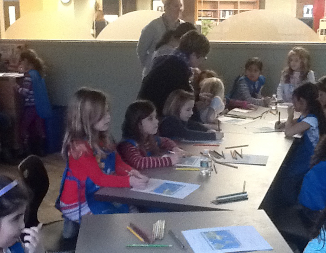 Girl Scouts in Mountainside, NJ writing letters to students in Zambia