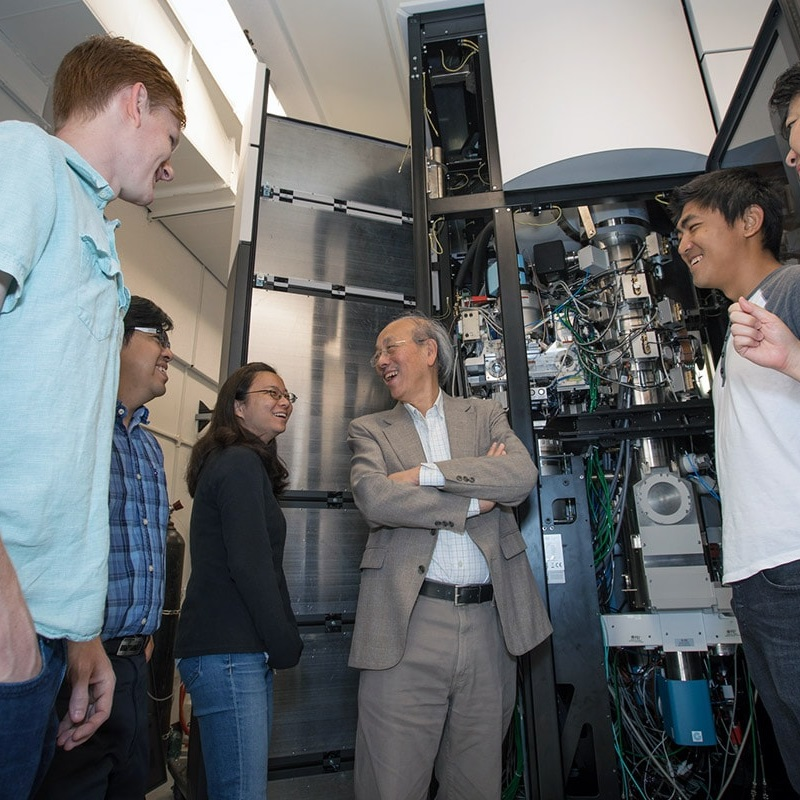 Professor Wah Chiu and members of the new Stanford-SLAC cryo-EM team stand in front of a cryo-EM instrument as work nears completion on their new facility at SLAC.