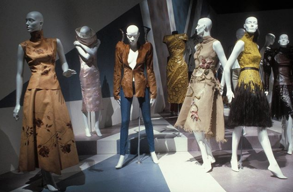 screenshot from Museum at FIT Instagram post of Alexander McQueen garments on mannequins
