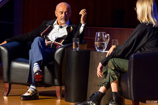 Christian Louboutin talking to Valerie Steele on stage