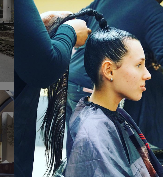 screenshot of FIT Instagram photo of student getting hair styled for Bloomingdales runway show by Runway 27 students