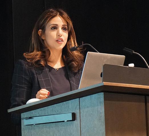 Sama'a Al-Hamdani at a podium