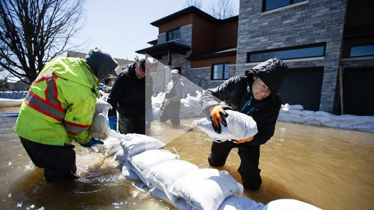 people working in flood water