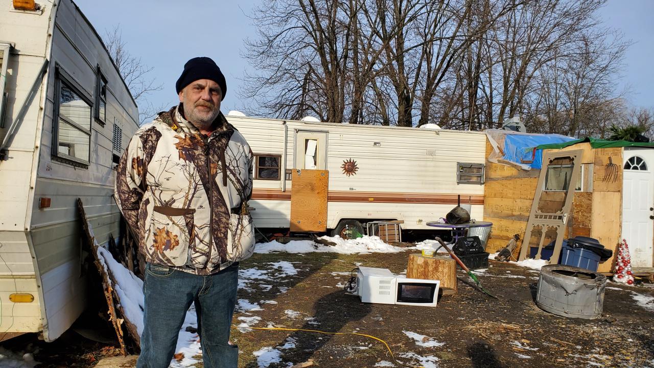 a man outside his trailer