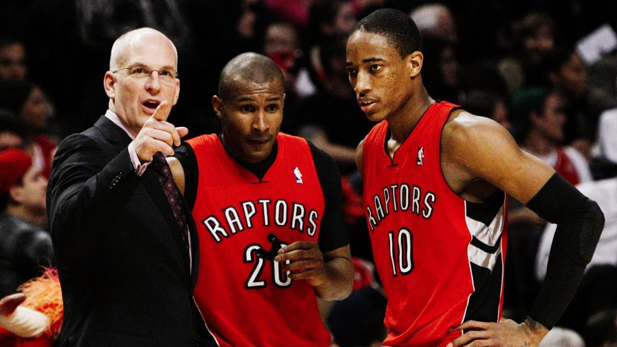 Coach Jay Triano with two Toronto Raptors players