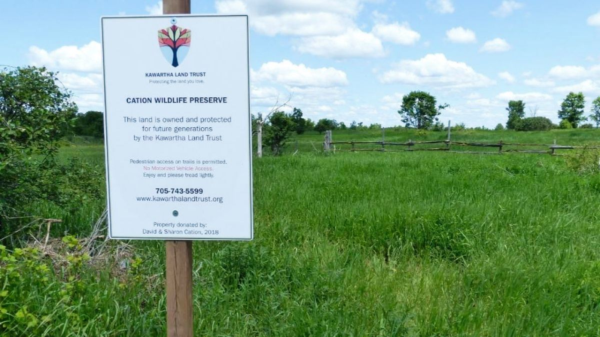 a sign that says Canadian Wildlife Preserve