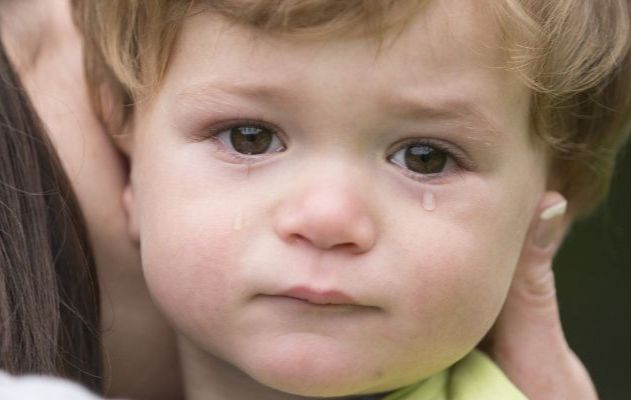 Toddler aged boy with tears in his eys