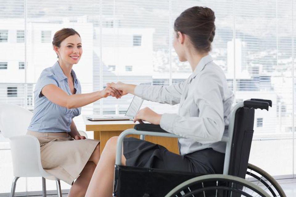 Two women in an office, one in a wheelchair