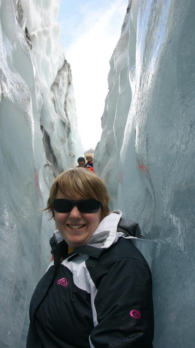 Photo of Kristi inbetween two glaciers
