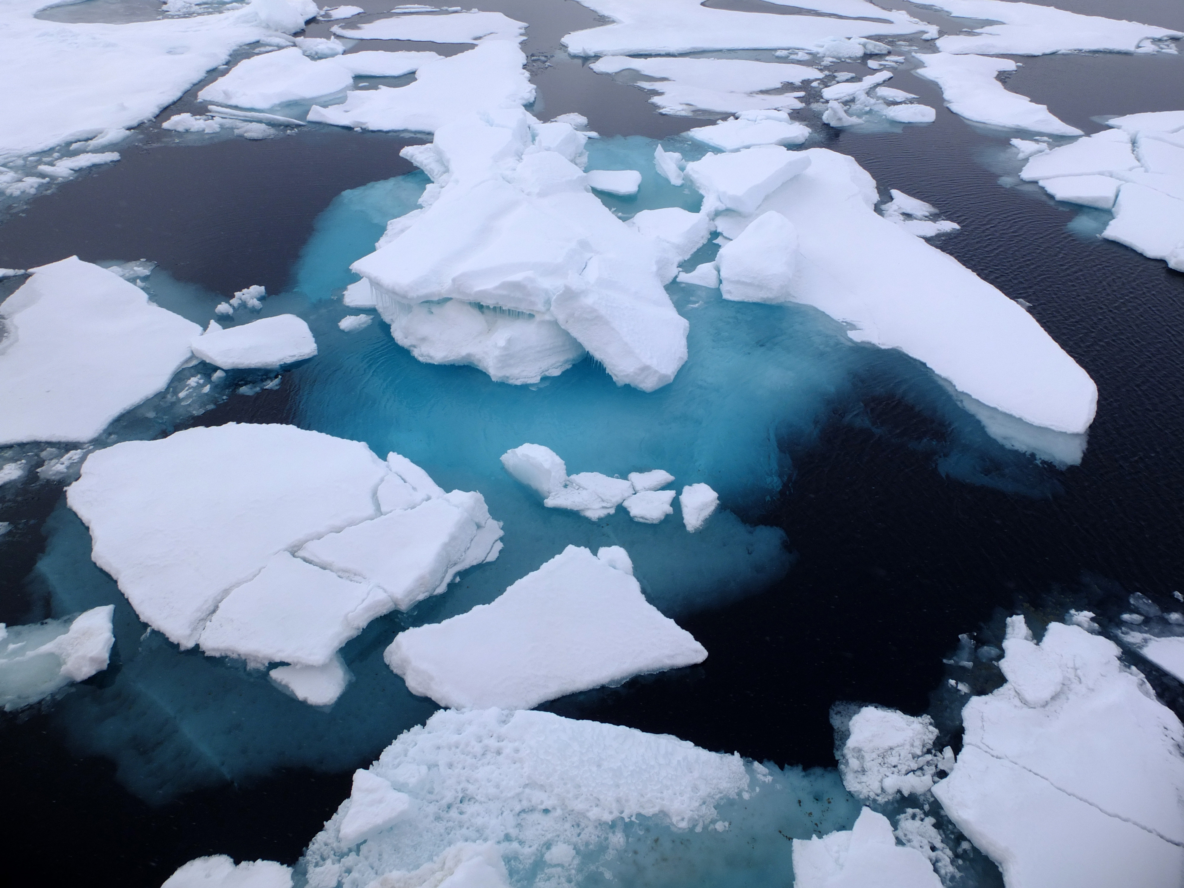 Light coloured ice, with darker water