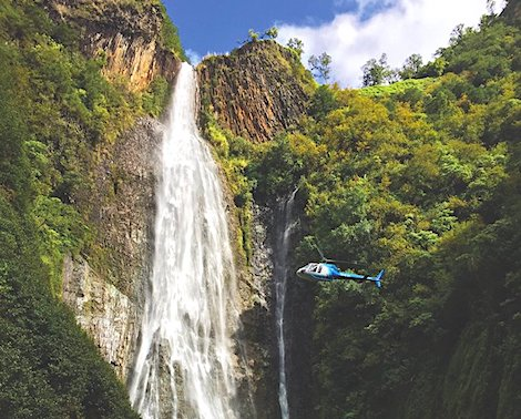 Helicopter passing Manawaiopuna Falls on Kauai