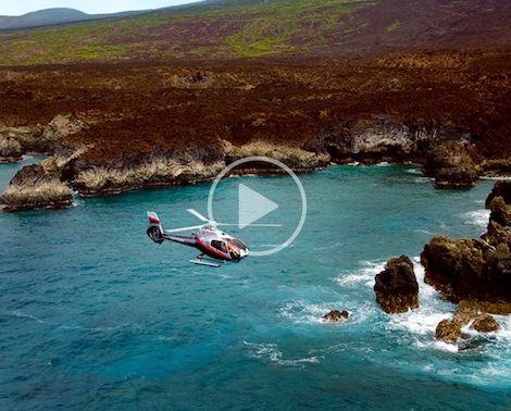 Aerial view of Maverick Helicopter above breathtaking Maui shoreline