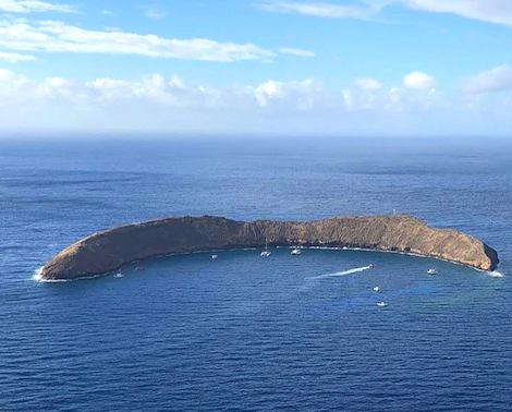 Aerial view of Molokini Crater in the middle of the ocean off Maui's shores