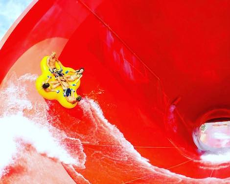 People riding Tornado extreme attraction at Wet'n'Wild Hawaii water park, island of Oahu