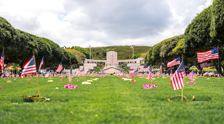 View of US flags at National Cemetery of the Pacific (Punchbowl) gravesites, Oahu