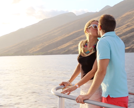 Couple kissing on the bow of the Pride of Maui sunset cruise