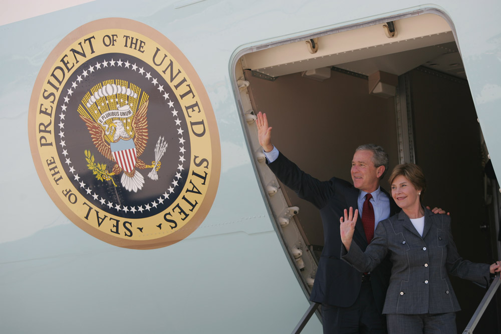 President George W. Bush and Laura Bush wave from Air Force One