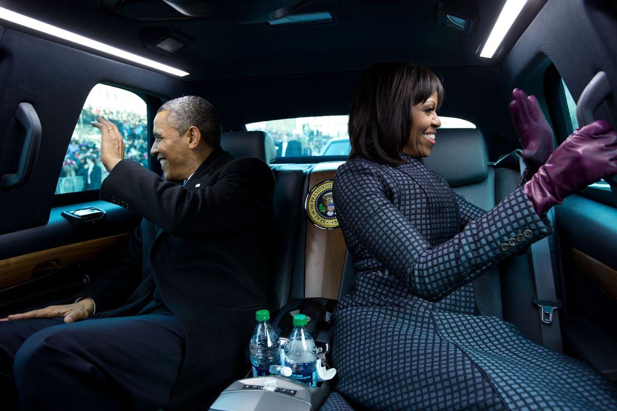 President Barack Obama and Michelle Obama ride in the inaugural parade