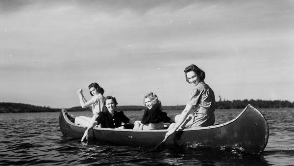 Photograph of four girls canoeing