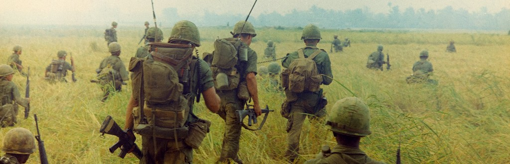 Photograph of Troops Moving across a Rice Field in Search of Viet Cong, 1/23/1966 [Detail]