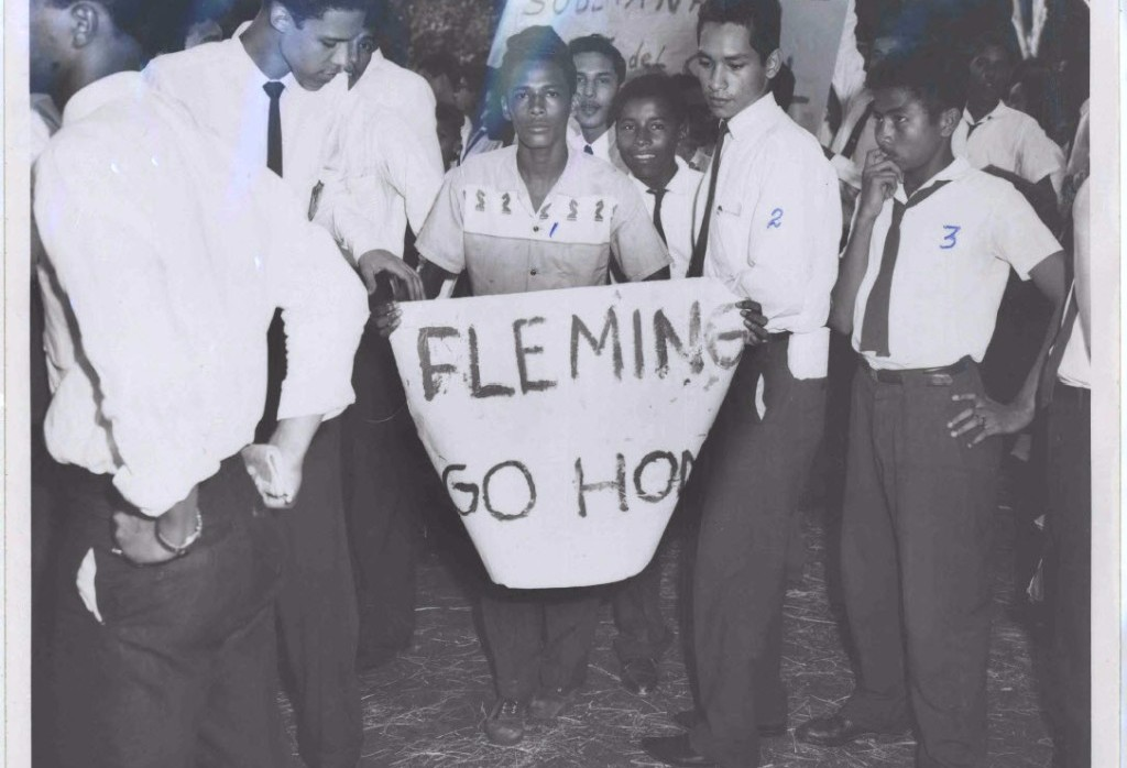 Photograph of Student with a Banner saying Fleming Go Home