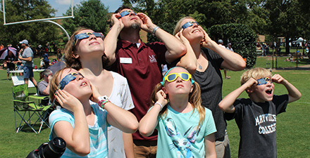 Family views solar eclipse