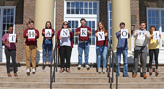 """Students hold """"Thank You"""" sign"""