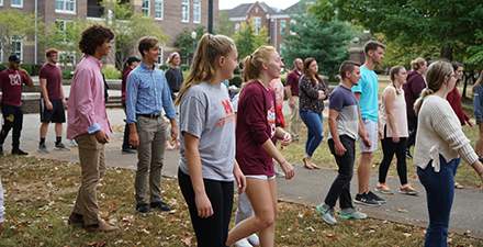 Students line dancing during kick-off rally