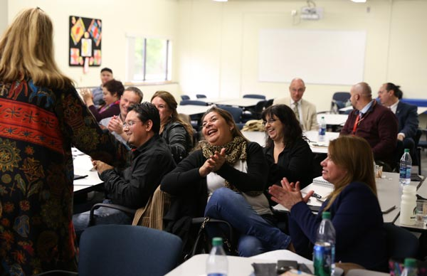 Argentinian educators applaud during a local presentation.