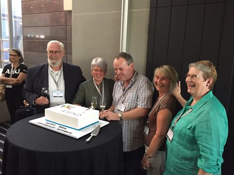 Jenny Shaw, Rita Jennings, Judy Hartley, Trevor Allen and Doug McGinn  cut the cake