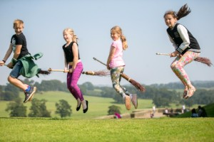 Children flying broomsticks