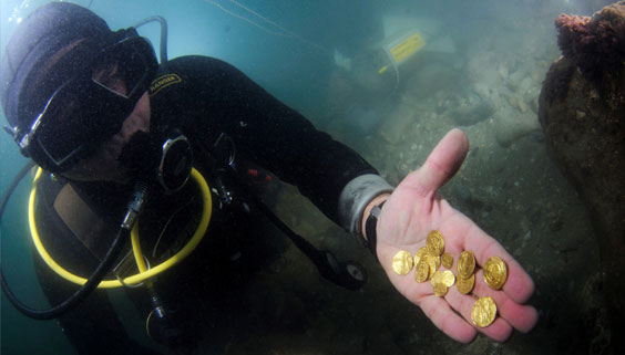 Collecting gold treasure from the seabed.