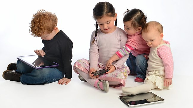 children in front of screens