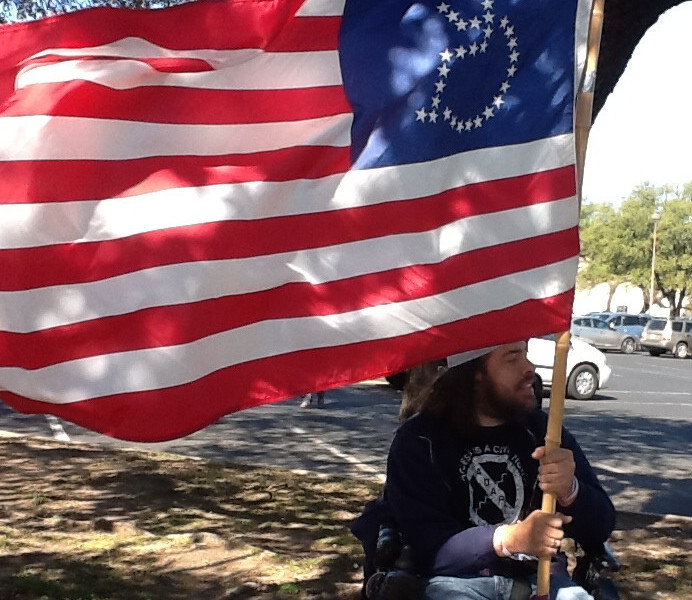Advocate holding ADAPT Flag