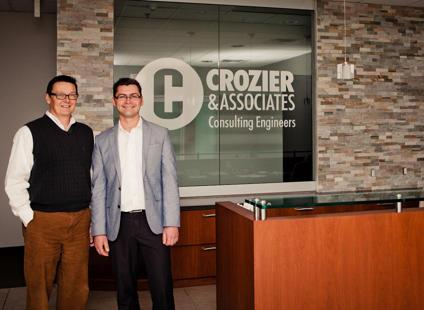 1)	Christopher Crozier, P.Eng, Principle (on left) and Nick Mocan, M.Sc., P.Eng., Associate -  in the Crozier & Associates reception lobby at 2800 High Point